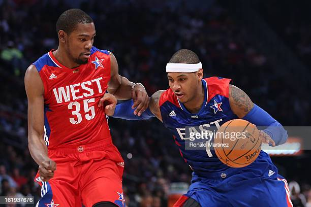Carmelo Anthony of the New York Knicks and the Eastern Conference drives on Kevin Durant of the Oklahoma City Thunder and the Western Conference...