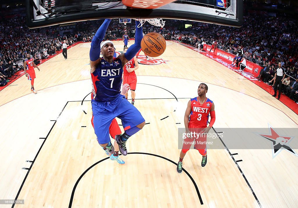 Carmelo Anthony #7 of the New York Knicks and the Eastern Conference dunks the ball in the first half during the 2013 NBA All-Star game at the Toyota Center on February 17, 2013 in Houston, Texas.