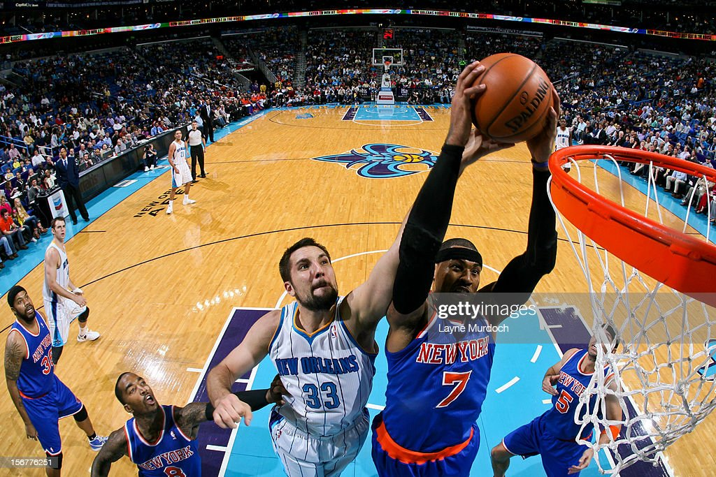 <a gi-track='captionPersonalityLinkClicked' href=/galleries/search?phrase=Carmelo+Anthony&family=editorial&specificpeople=201494 ng-click='$event.stopPropagation()'>Carmelo Anthony</a> #7 of the New York Knicks attempts a dunk against Ryan Anderson #33 of the New Orleans Hornets on November 20, 2012 at the New Orleans Arena in New Orleans, Louisiana.