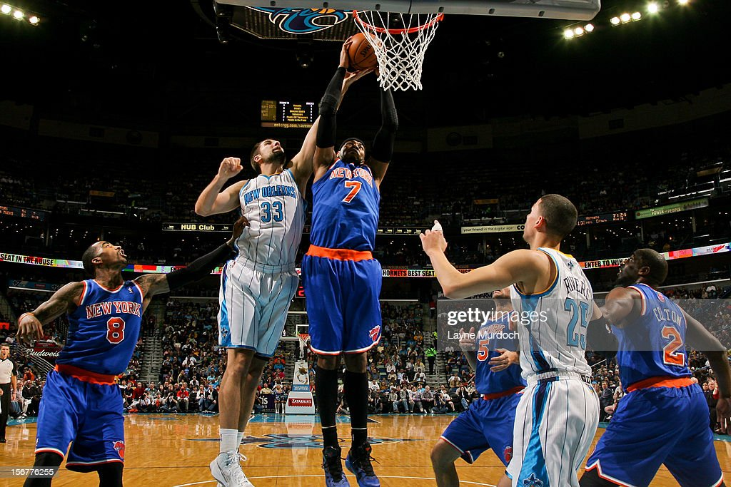 Carmelo Anthony #7 of the New York Knicks attempts a dunk against Ryan Anderson #33 of the New Orleans Hornets on November 20, 2012 at the New Orleans Arena in New Orleans, Louisiana.
