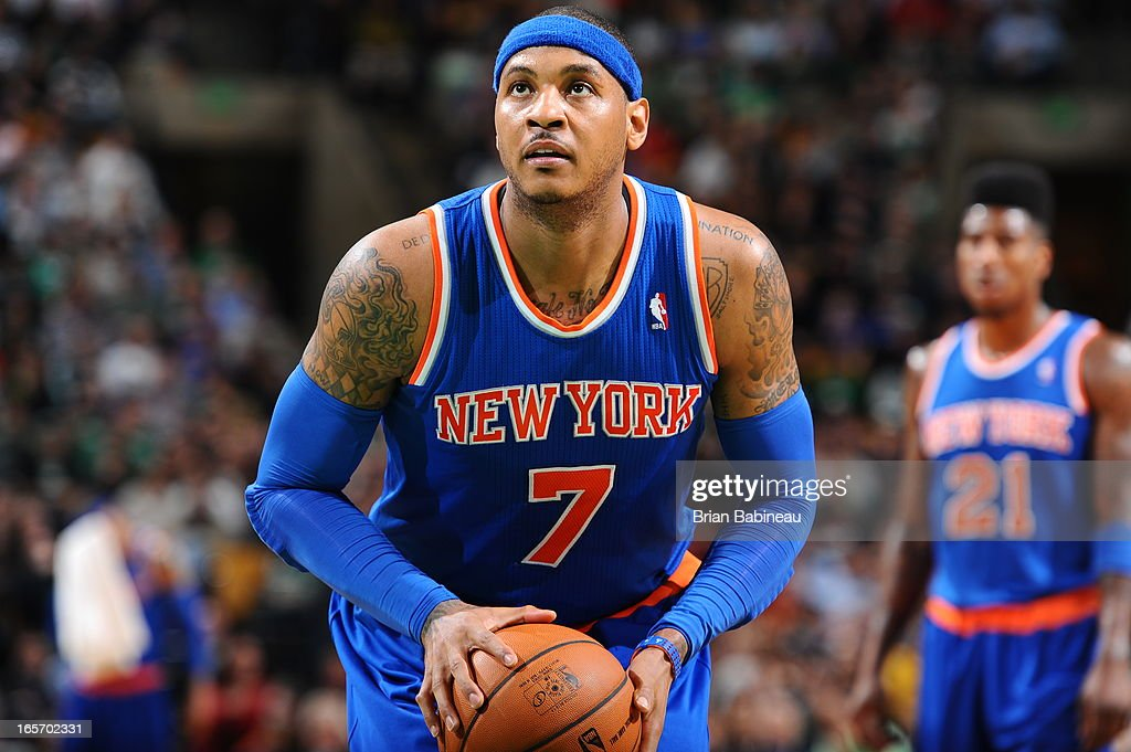 <a gi-track='captionPersonalityLinkClicked' href=/galleries/search?phrase=Carmelo+Anthony&family=editorial&specificpeople=201494 ng-click='$event.stopPropagation()'>Carmelo Anthony</a> #7 of the New York Knicks attempts a foul shot against the Boston Celtics on March 26, 2013 at the TD Garden in Boston, Massachusetts.
