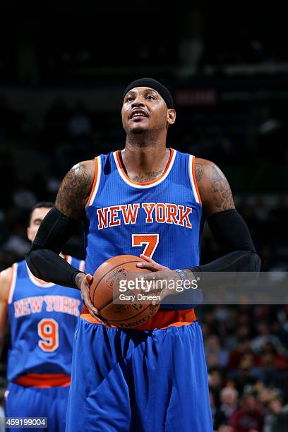 Carmelo Anthony of the New York Knicks attempts a free throw against the Milwaukee Bucks on November 18 2014 at the BMO Harris Bradley Center in...