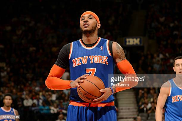 Carmelo Anthony of the New York Knicks attempts a free throw against the Toronto Raptors on April 11 2014 at the Air Canada Centre in Toronto Ontario...