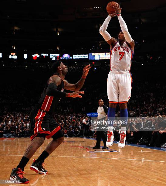Carmelo Anthony of the New York Knicks attempts a shot in the first quarter against LeBron James of the Miami Heat in Game Three of the Eastern...