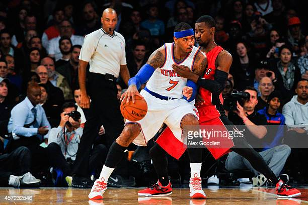 Carmelo Anthony of the New York Knicks attempts to dribble around Terrence Ross of the Toronto Raptors in the first quarter at Madison Square Garden...