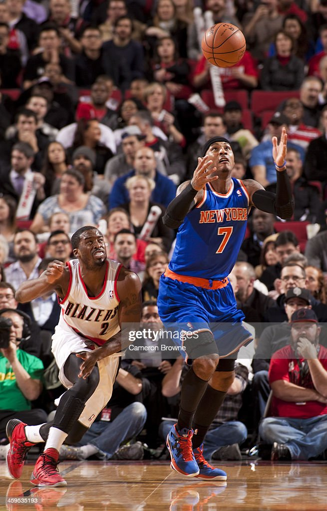 <a gi-track='captionPersonalityLinkClicked' href=/galleries/search?phrase=Carmelo+Anthony&family=editorial&specificpeople=201494 ng-click='$event.stopPropagation()'>Carmelo Anthony</a> #7 of the New York Knicks catches a loose ball against the Portland Trail Blazers on November 25, 2013 at the Moda Center Arena in Portland, Oregon.