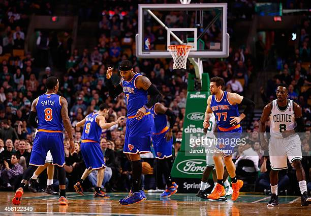 Carmelo Anthony of the New York Knicks celebrates a threepoint shot in the first quarter against the Boston Celtics during the game at TD Garden on...