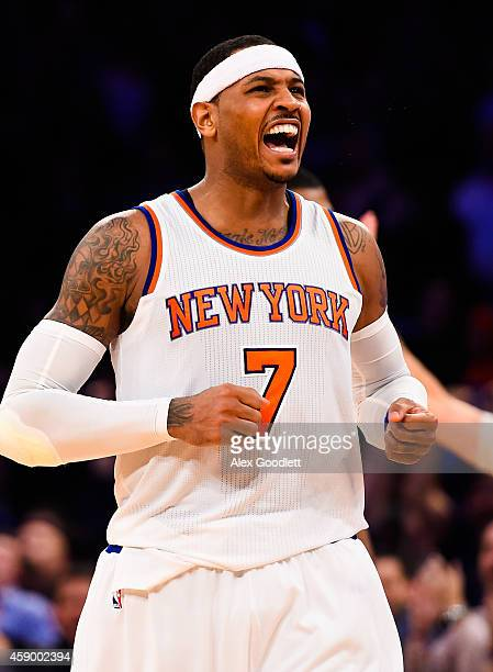 Carmelo Anthony of the New York Knicks celebrates after making a three point basket late in the fourth quarter during a game against the Utah Jazz at...