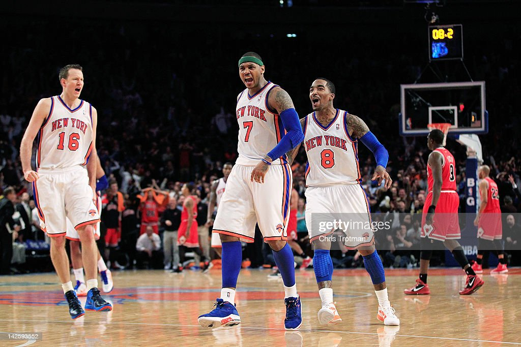 <a gi-track='captionPersonalityLinkClicked' href=/galleries/search?phrase=Carmelo+Anthony&family=editorial&specificpeople=201494 ng-click='$event.stopPropagation()'>Carmelo Anthony</a> #7 of the New York Knicks celebrates his game winning three pointer with his teammates <a gi-track='captionPersonalityLinkClicked' href=/galleries/search?phrase=Steve+Novak&family=editorial&specificpeople=693015 ng-click='$event.stopPropagation()'>Steve Novak</a> #16 of the New York Knicks and <a gi-track='captionPersonalityLinkClicked' href=/galleries/search?phrase=J.R.+Smith&family=editorial&specificpeople=201766 ng-click='$event.stopPropagation()'>J.R. Smith</a> #8 of the New York Knicks against the Chicago Bulls at Madison Square Garden on April 8, 2012 in New York City.