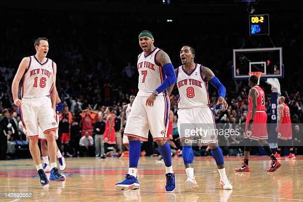 Carmelo Anthony of the New York Knicks celebrates his game winning three pointer with his teammates Steve Novak of the New York Knicks and JR Smith...