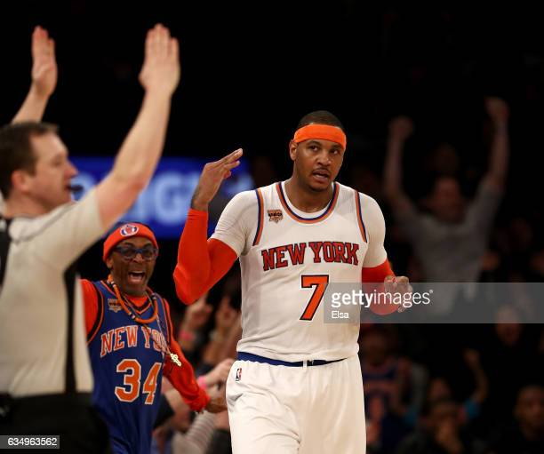Carmelo Anthony of the New York Knicks celebrates his three point shot in the final minutes of the game against the San Antonio Spurs at Madison...
