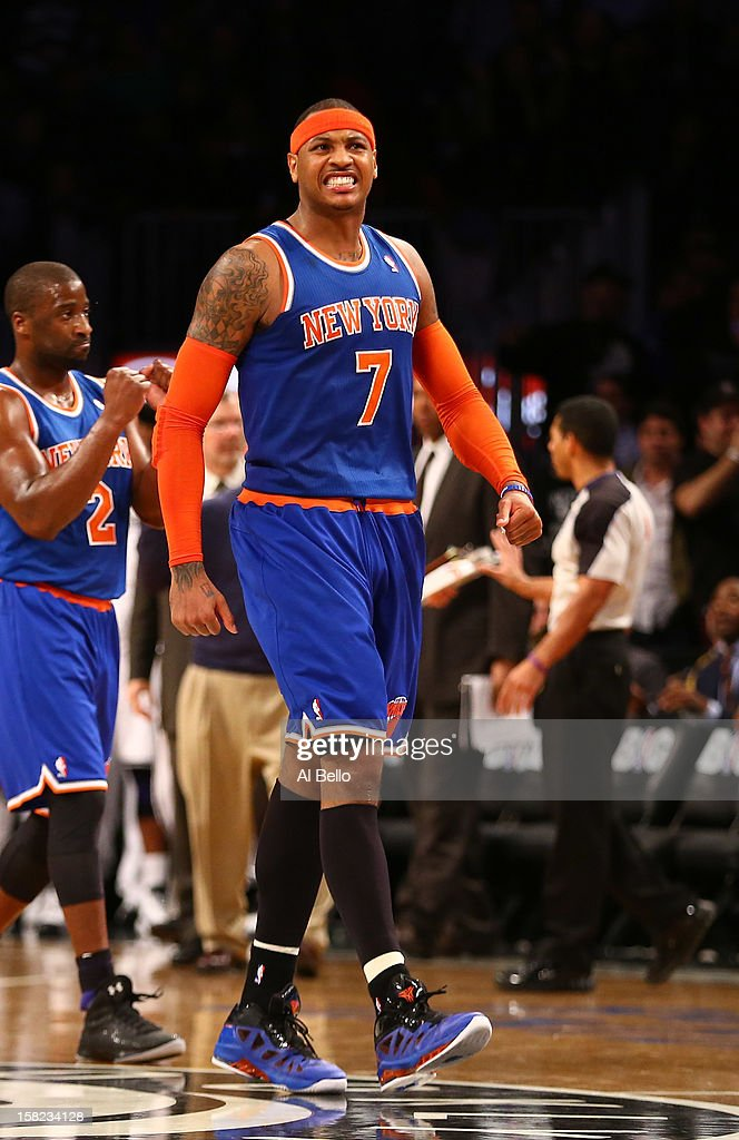 Carmelo Anthony #7 of the New York Knicks celebrates scoring a basket against the Brooklyn Nets during their game at the Barclays Center on December 11, 2012 in the Brooklyn borough of New York City.