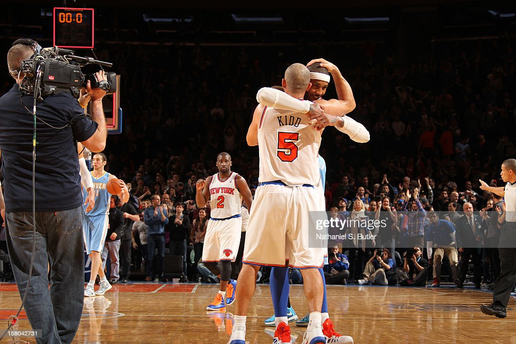 <a gi-track='captionPersonalityLinkClicked' href=/galleries/search?phrase=Carmelo+Anthony&family=editorial&specificpeople=201494 ng-click='$event.stopPropagation()'>Carmelo Anthony</a> #7 of the New York Knicks celebrates with teammate <a gi-track='captionPersonalityLinkClicked' href=/galleries/search?phrase=Jason+Kidd&family=editorial&specificpeople=201560 ng-click='$event.stopPropagation()'>Jason Kidd</a> #5 on December 9, 2012 at Madison Square Garden in New York City.