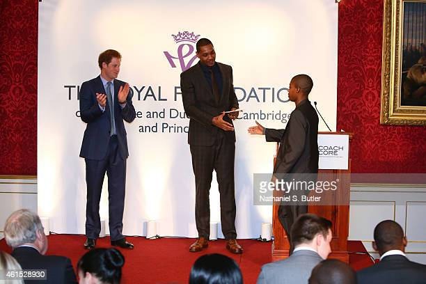 Carmelo Anthony of the New York Knicks congratulates the graduates at the Coach Core graduation ceremony This event is part of the partnership...