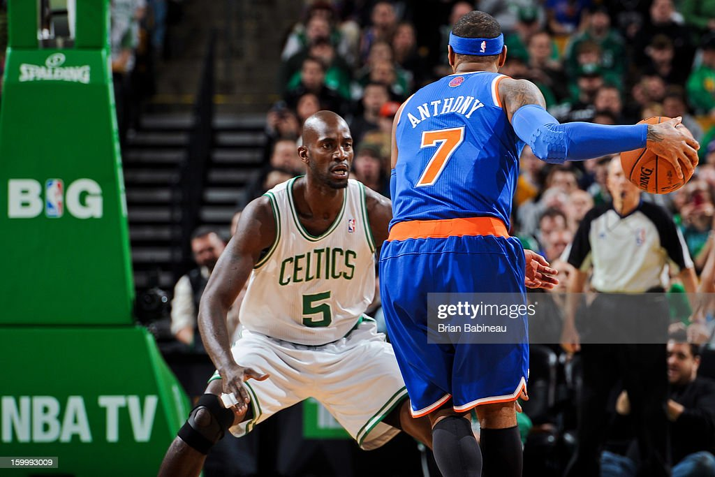 Carmelo Anthony #7 of the New York Knicks controls the ball against Kevin Garnett #5 of the Boston Celtics on January 24, 2013 at the TD Garden in Boston, Massachusetts.