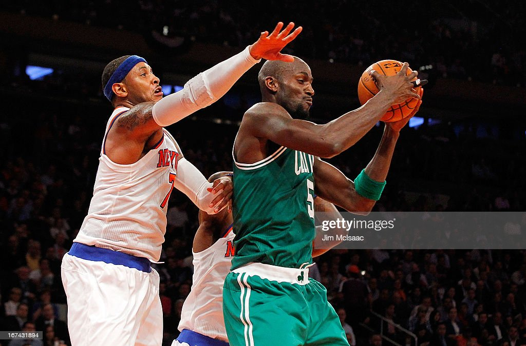 Carmelo Anthony #7 of the New York Knicks defends against Kevin Garnett #5 of the Boston Celtics during Game Two of the Eastern Conference Quarterfinals of the 2013 NBA Playoffs on April 23, 2013 at Madison Square Garden in New York City. The Knicks defeated the Celtics 87-71.