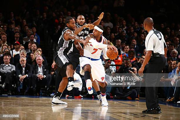 Carmelo Anthony of the New York Knicks defends the ball against the San Antonio Spurs during the game on November 2 2015 at Madison Square Garden in...