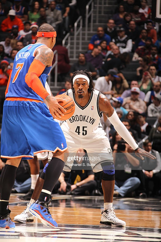 Carmelo Anthony #7 of the New York Knicks dribbles against Gerald Wallace #45 of the Brooklyn Nets December 11, 2012 at the Barclays Center in the Brooklyn borough of New York City.