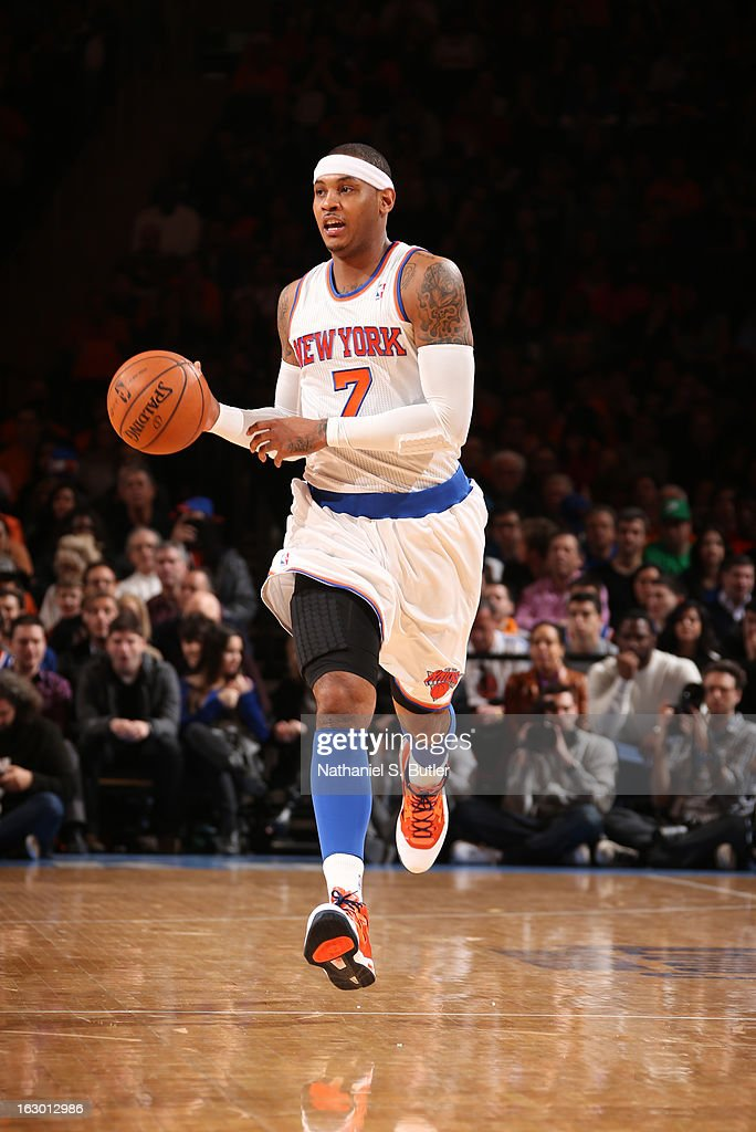 Carmelo Anthony #7 of the New York Knicks dribbles in a game against the Miami Heat on March 3, 2013 at Madison Square Garden in New York City.
