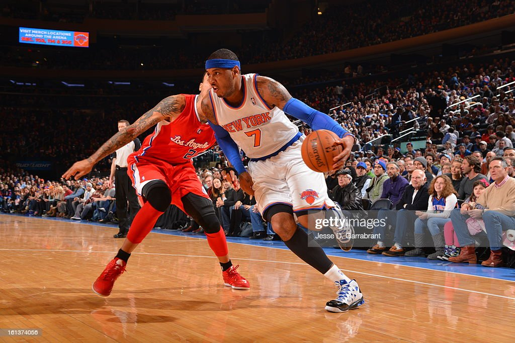 Carmelo Anthony #7 of the New York Knicks dribbles to the basket against Matt Barnes #22 of the Los Angeles Clippers during the game at Madison Square Garden on February 10, 2013 in New York City.