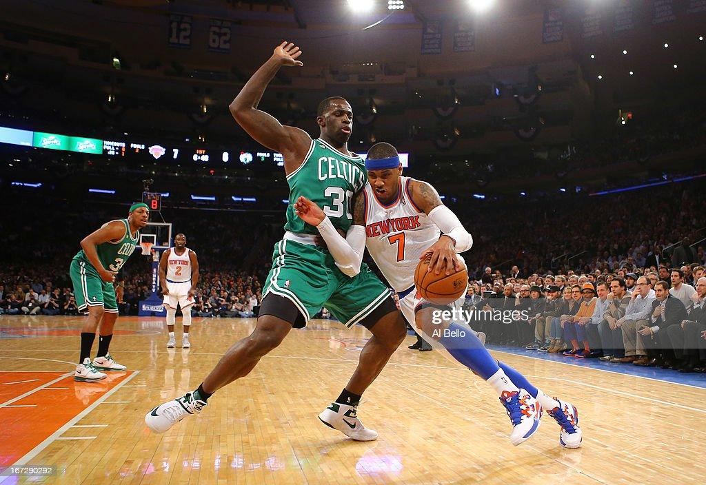 Carmelo Anthony #7 of the New York Knicks drives against Brandon Bass #30 of the Boston Celtics during Game two of the Eastern Conference Quarterfinals of the 2013 NBA Playoffs at Madison Square Garden on April 23, 2013 in New York City.