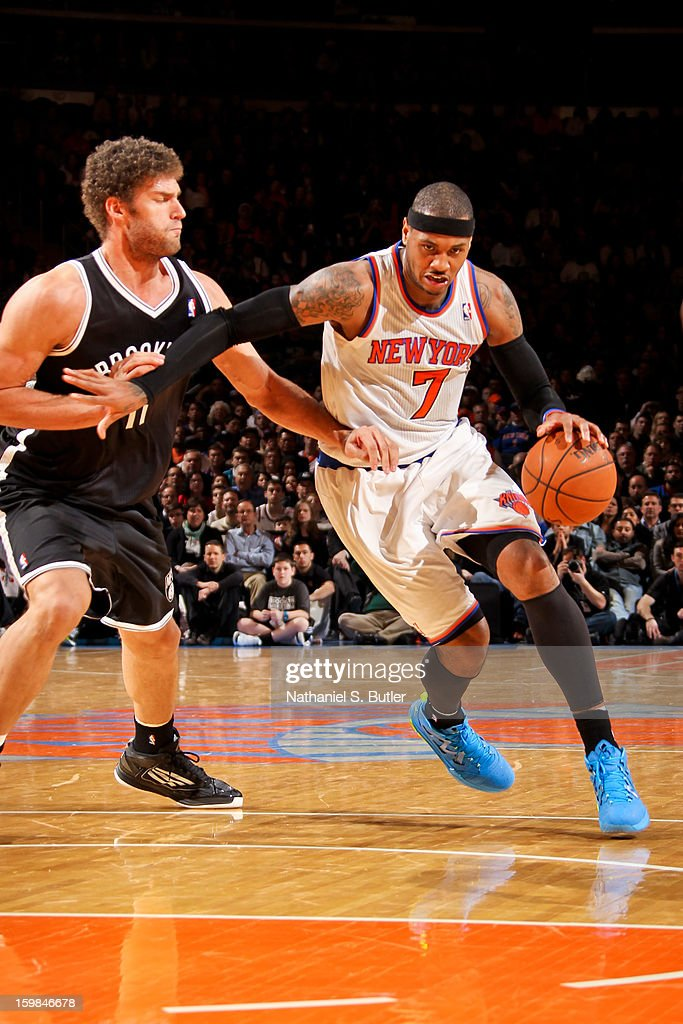 Carmelo Anthony #7 of the New York Knicks drives against Brook Lopez #11 of the Brooklyn Nets on January 21, 2013 at Madison Square Garden in New York City.