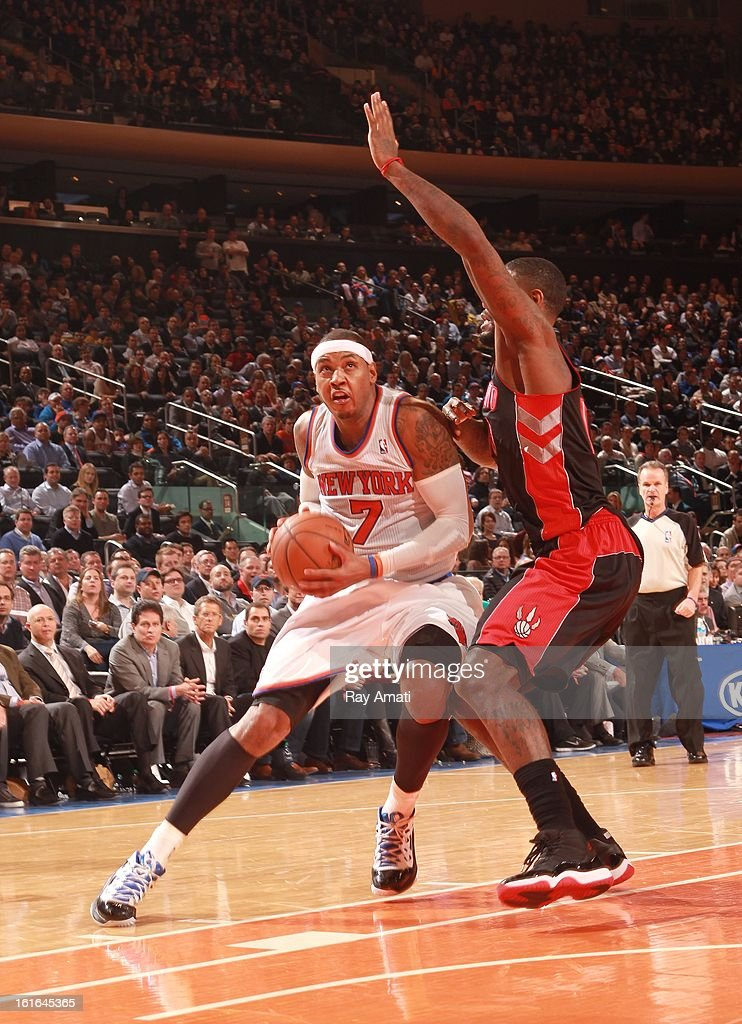 Carmelo Anthony #7 of the New York Knicks drives against John Lucas III #5 of the Toronto Raptors on February 13, 2013 at Madison Square Garden in New York City.