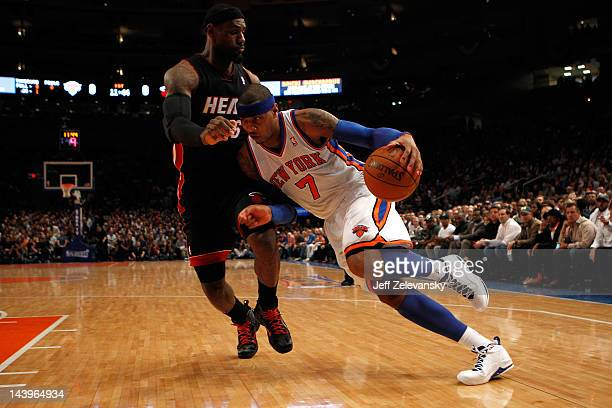 Carmelo Anthony of the New York Knicks drives against LeBron James of the Miami Heat in the first quarter of Game Four of the Eastern Conference...