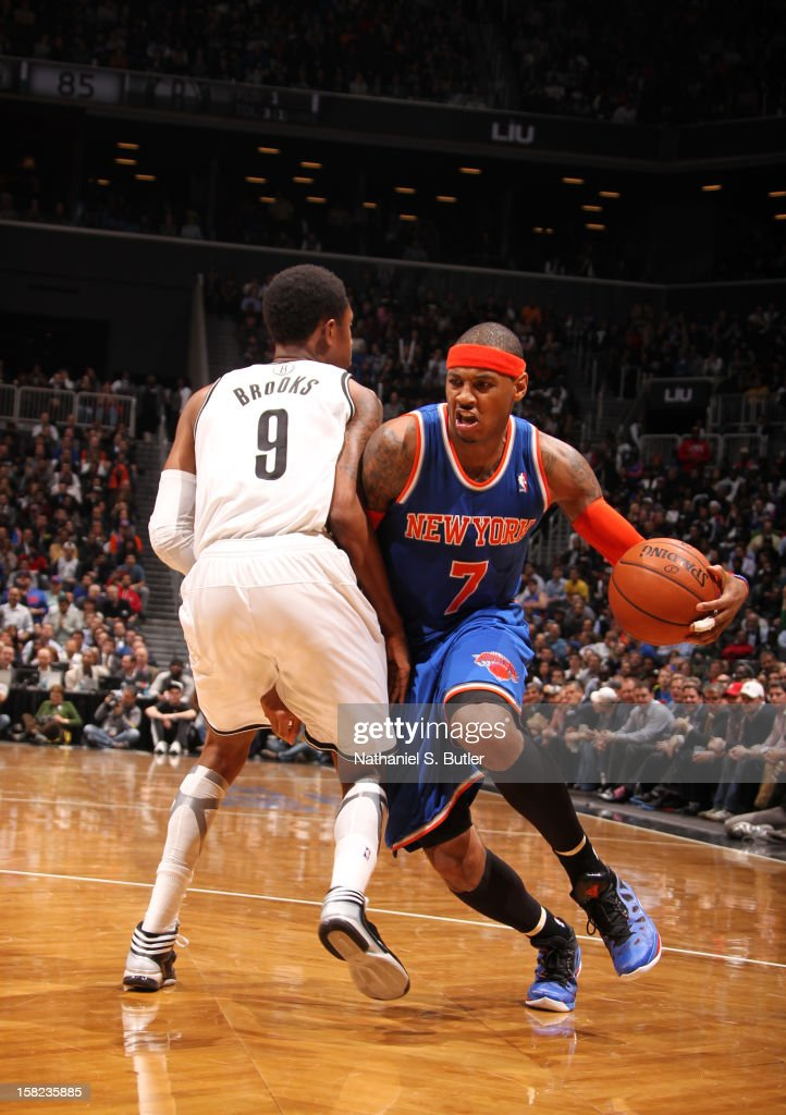 Carmelo Anthony #7 of the New York Knicks drives against MarShon Brooks #9 of the Brooklyn Nets on December 11, 2012 at the Barclays Center in the Brooklyn borough of New York City.