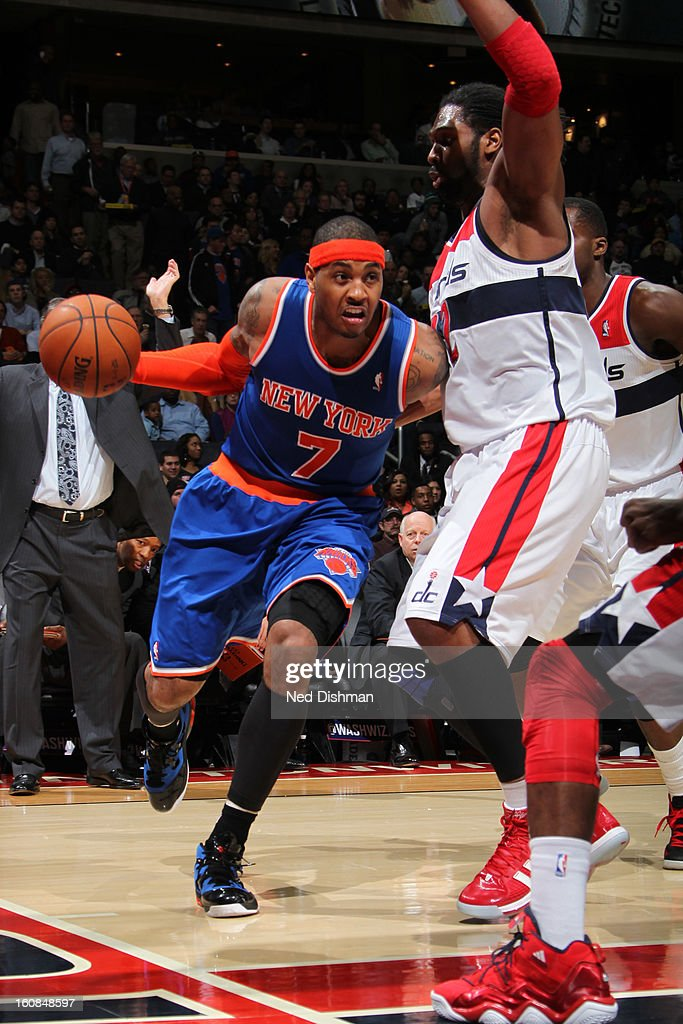<a gi-track='captionPersonalityLinkClicked' href=/galleries/search?phrase=Carmelo+Anthony&family=editorial&specificpeople=201494 ng-click='$event.stopPropagation()'>Carmelo Anthony</a> #7 of the New York Knicks drives against Nene #42 of the Washington Wizards during the game at the Verizon Center on February 6, 2013 in Washington, DC.