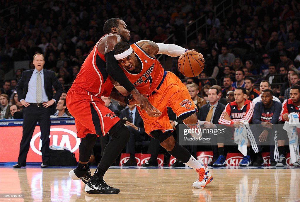 <a gi-track='captionPersonalityLinkClicked' href=/galleries/search?phrase=Carmelo+Anthony&family=editorial&specificpeople=201494 ng-click='$event.stopPropagation()'>Carmelo Anthony</a> #7 of the New York Knicks drives against <a gi-track='captionPersonalityLinkClicked' href=/galleries/search?phrase=Paul+Millsap&family=editorial&specificpeople=880017 ng-click='$event.stopPropagation()'>Paul Millsap</a> #4 of the Atlanta Hawks during the second half at Madison Square Garden on November 16, 2013 in New York City. The Hawks defeat the Knicks 110-90.