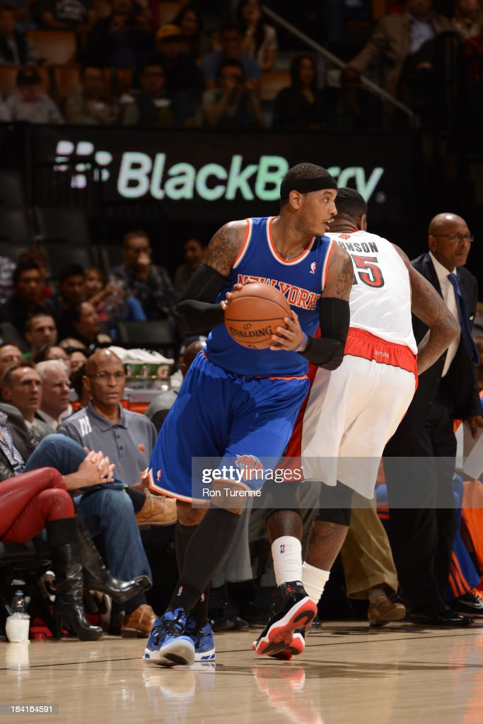 Carmelo Anthony #7 of the New York Knicks drives against the Toronto Raptors during the game on October 11, 2013 at the Air Canada Centre in Toronto, Ontario, Canada.