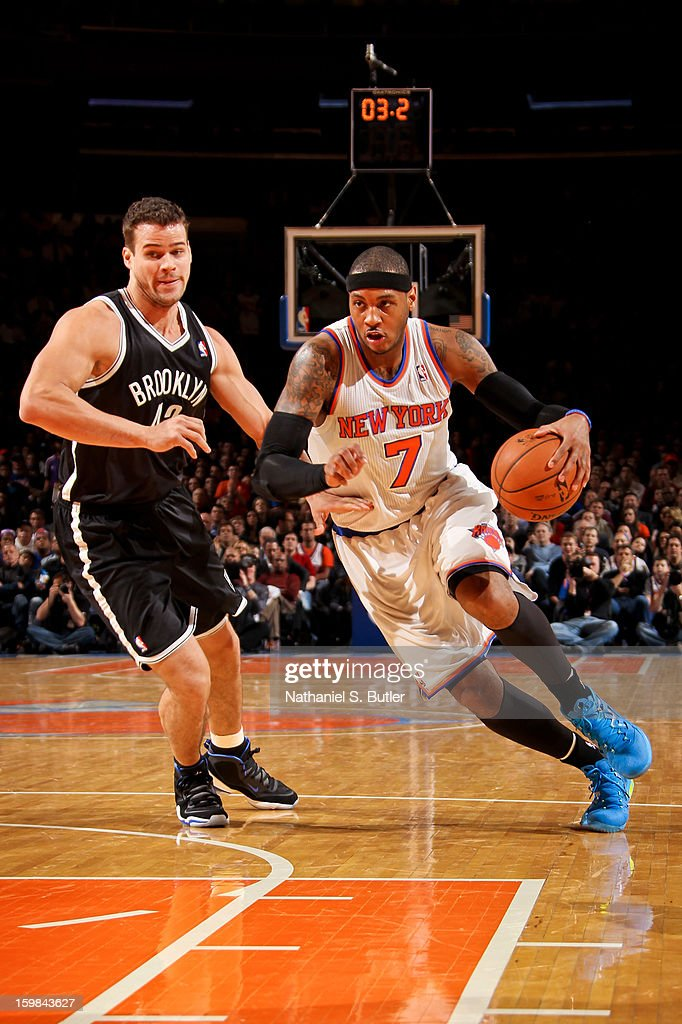 Carmelo Anthony #7 of the New York Knicks drives ahead of Kris Humphries #43 of the Brooklyn Nets on January 21, 2013 at Madison Square Garden in New York City.