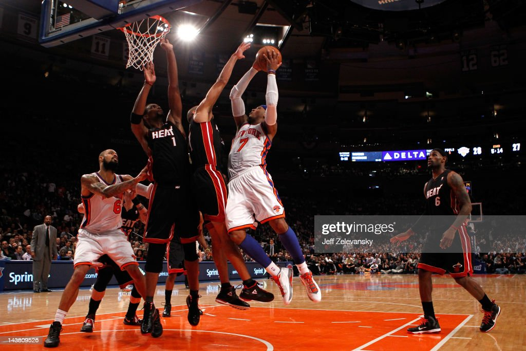 <a gi-track='captionPersonalityLinkClicked' href=/galleries/search?phrase=Carmelo+Anthony&family=editorial&specificpeople=201494 ng-click='$event.stopPropagation()'>Carmelo Anthony</a> #7 of the New York Knicks drives for a shot attempt in the first half against <a gi-track='captionPersonalityLinkClicked' href=/galleries/search?phrase=Shane+Battier&family=editorial&specificpeople=201814 ng-click='$event.stopPropagation()'>Shane Battier</a> #31 and <a gi-track='captionPersonalityLinkClicked' href=/galleries/search?phrase=Chris+Bosh&family=editorial&specificpeople=201574 ng-click='$event.stopPropagation()'>Chris Bosh</a> #1 of the Miami Heat in Game Three of the Eastern Conference Quarterfinals in the 2012 NBA Playoffs on May 3, 2012 at Madison Square Garden in New York City.