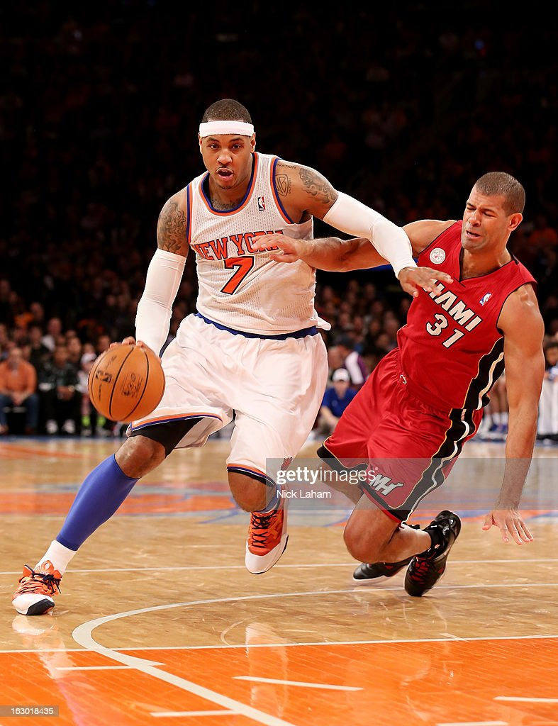 Carmelo Anthony #7 of the New York Knicks drives past a falling Shane Battier #31 of the Miami Heat at Madison Square Garden on March 3, 2013 in New York City.NOTE