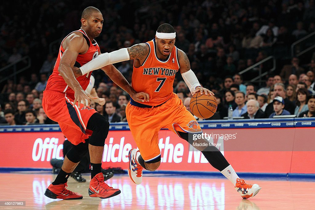 <a gi-track='captionPersonalityLinkClicked' href=/galleries/search?phrase=Carmelo+Anthony&family=editorial&specificpeople=201494 ng-click='$event.stopPropagation()'>Carmelo Anthony</a> #7 of the New York Knicks drives past <a gi-track='captionPersonalityLinkClicked' href=/galleries/search?phrase=Al+Horford&family=editorial&specificpeople=699030 ng-click='$event.stopPropagation()'>Al Horford</a> #15 of the Atlanta Hawks during the second half at Madison Square Garden on November 16, 2013 in New York City. The Hawks defeat the Knicks 110-90.