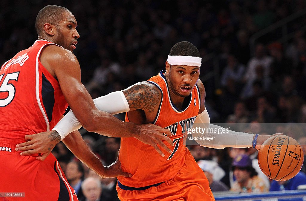 Carmelo Anthony #7 of the New York Knicks drives past Al Horford #15 of the Atlanta Hawks during the second half at Madison Square Garden on November 16, 2013 in New York City. The Hawks defeat the Knicks 110-90.