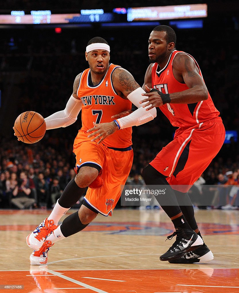 Carmelo Anthony #7 of the New York Knicks drives past Paul Millsap #4 of the Atlanta Hawks during the second half at Madison Square Garden on November 16, 2013 in New York City. The Hawks defeat the Knicks 110-90.