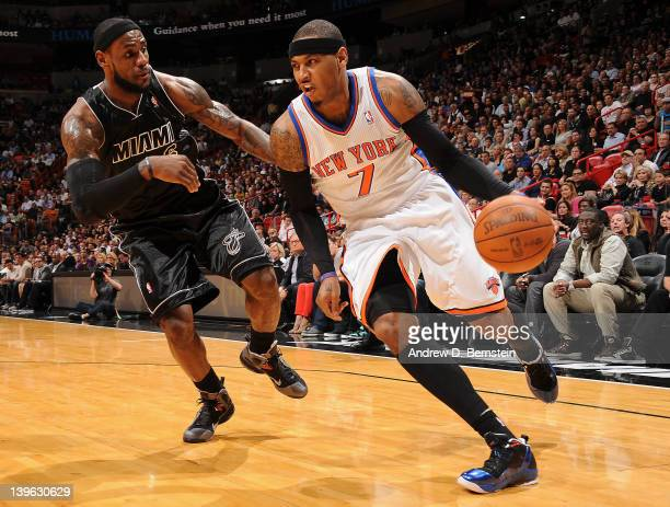 Carmelo Anthony of the New York Knicks drives to the basket against LeBron James of the Miami Heat during the game on February 23 2012 at American...