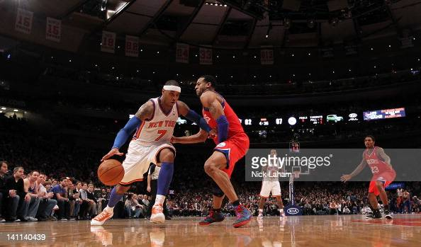Carmelo Anthony of the New York Knicks drives to the basket against Andre Iguodala of the Philadelphia 76ers at Madison Square Garden on March 11...