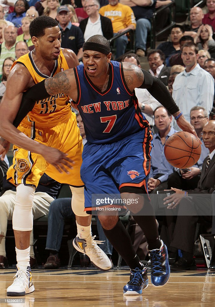 <a gi-track='captionPersonalityLinkClicked' href=/galleries/search?phrase=Carmelo+Anthony&family=editorial&specificpeople=201494 ng-click='$event.stopPropagation()'>Carmelo Anthony</a> #7 of the New York Knicks drives to the basket against <a gi-track='captionPersonalityLinkClicked' href=/galleries/search?phrase=Danny+Granger&family=editorial&specificpeople=553769 ng-click='$event.stopPropagation()'>Danny Granger</a> #33 of the Indiana Pacers on April 3, 2012 at Bankers Life Fieldhouse in Indianapolis, Indiana.