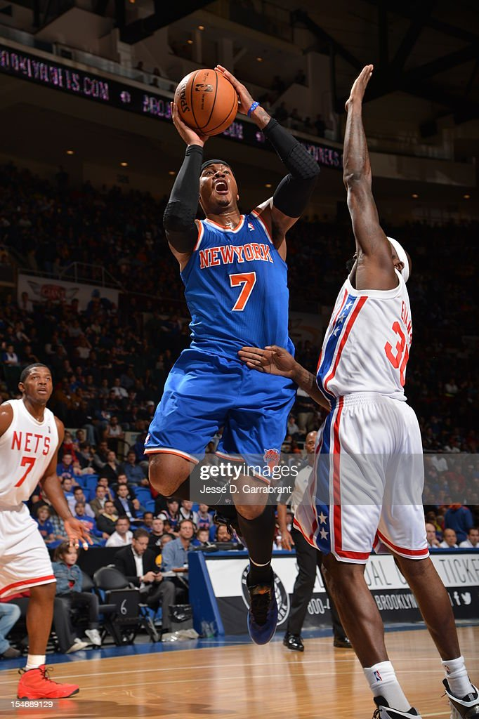 Carmelo Anthony #7 of the New York Knicks drives to the basket against the Brooklyn Nets during the game at the Nassau Veterans Memorial Coliseum on October 24, 2012 in Long Island, New York.