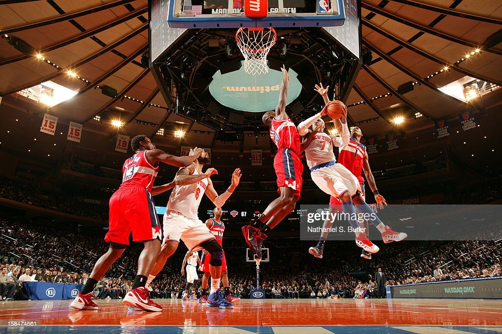 <a gi-track='captionPersonalityLinkClicked' href=/galleries/search?phrase=Carmelo+Anthony&family=editorial&specificpeople=201494 ng-click='$event.stopPropagation()'>Carmelo Anthony</a> #7 of the New York Knicks drives to the basket against the Washington Wizards on November 30 2012 at Madison Square Garden in New York City.