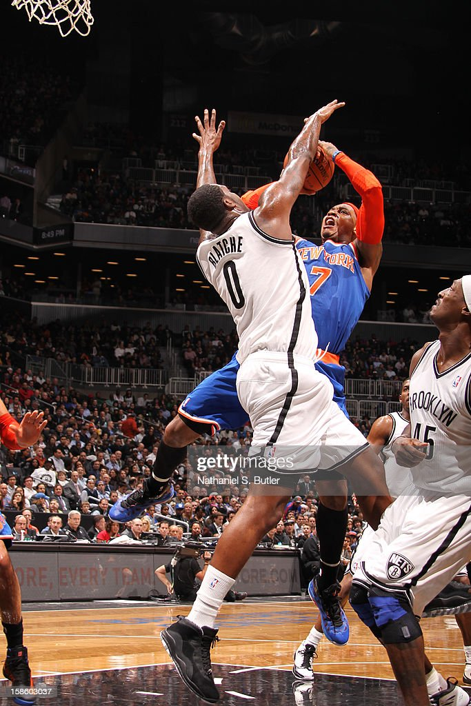 Carmelo Anthony #7 of the New York Knicks drives to the basket against Andray Blatche #0 of the Brooklyn Nets on December 11, 2012 at the Barclays Center in the Brooklyn borough of New York City.