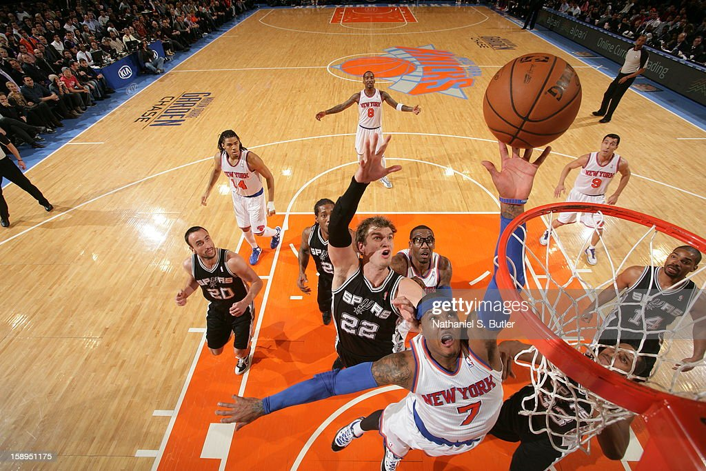 Carmelo Anthony #7 of the New York Knicks drives to the basket against Tiago Splitter #22 of the San Antonio Spurs on January 3, 2013 at Madison Square Garden in New York City.
