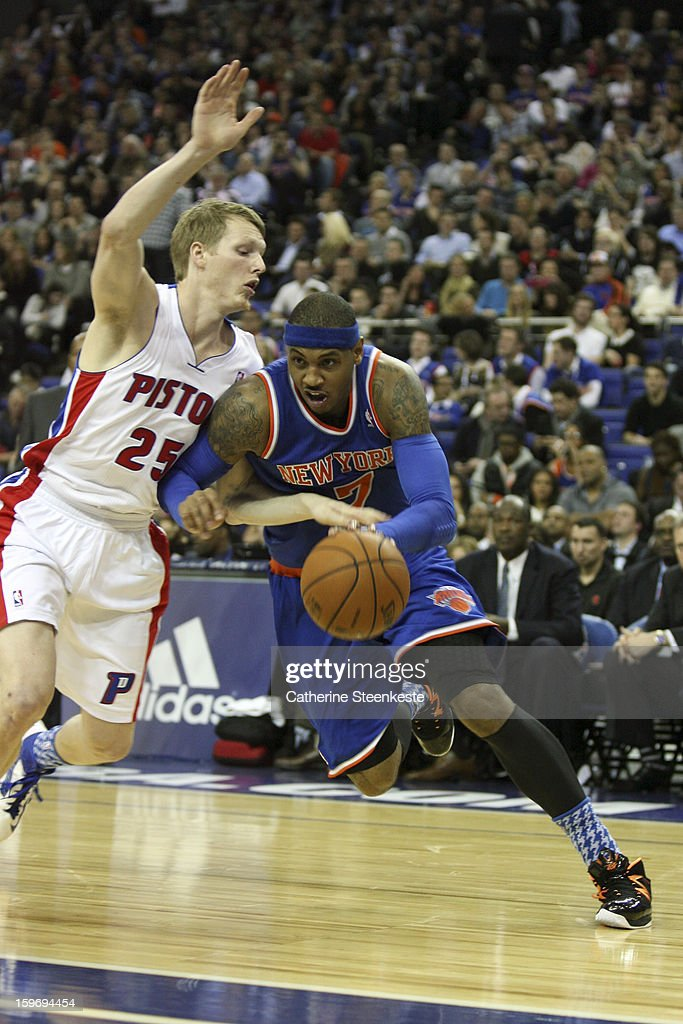 Carmelo Anthony #7 of the New York Knicks drives to the basket against Kyle Singler #25 of the Detroit Pistons during a game between the New York Knicks and the Detroit Pistons at the O2 Arena on January 17, 2013 in London, England.