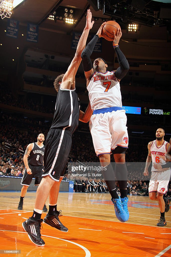 Carmelo Anthony #7 of the New York Knicks drives to the basket against the Brooklyn Nets on January 21, 2013 at Madison Square Garden in New York City.