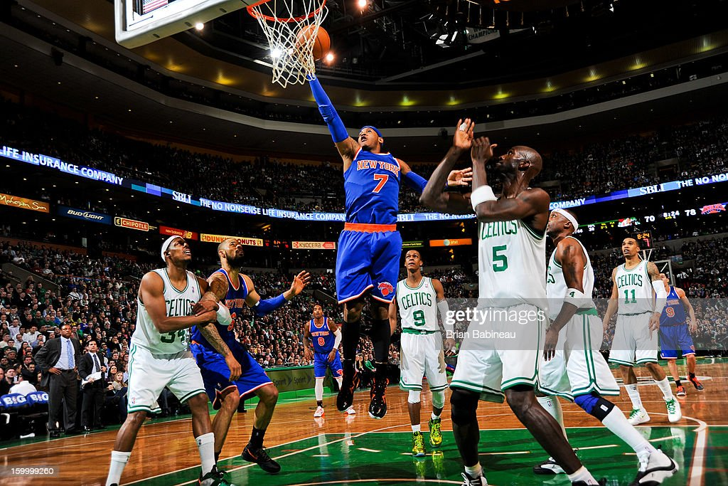 Carmelo Anthony #7 of the New York Knicks drives to the basket against Kevin Garnett #5 of the Boston Celtics on January 24, 2013 at the TD Garden in Boston, Massachusetts.