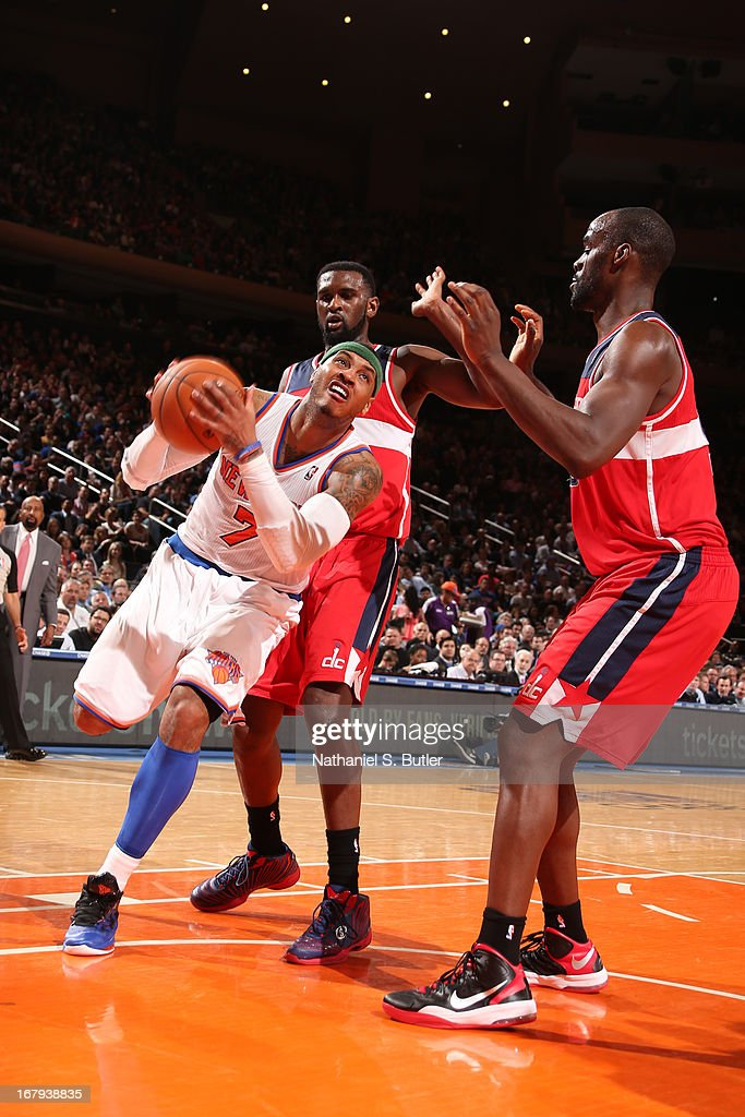Carmelo Anthony #7 of the New York Knicks drives to the basket against Emeka Okafor #50 of the Washington Wizards on April 9, 2013 at Madison Square Garden in New York City.