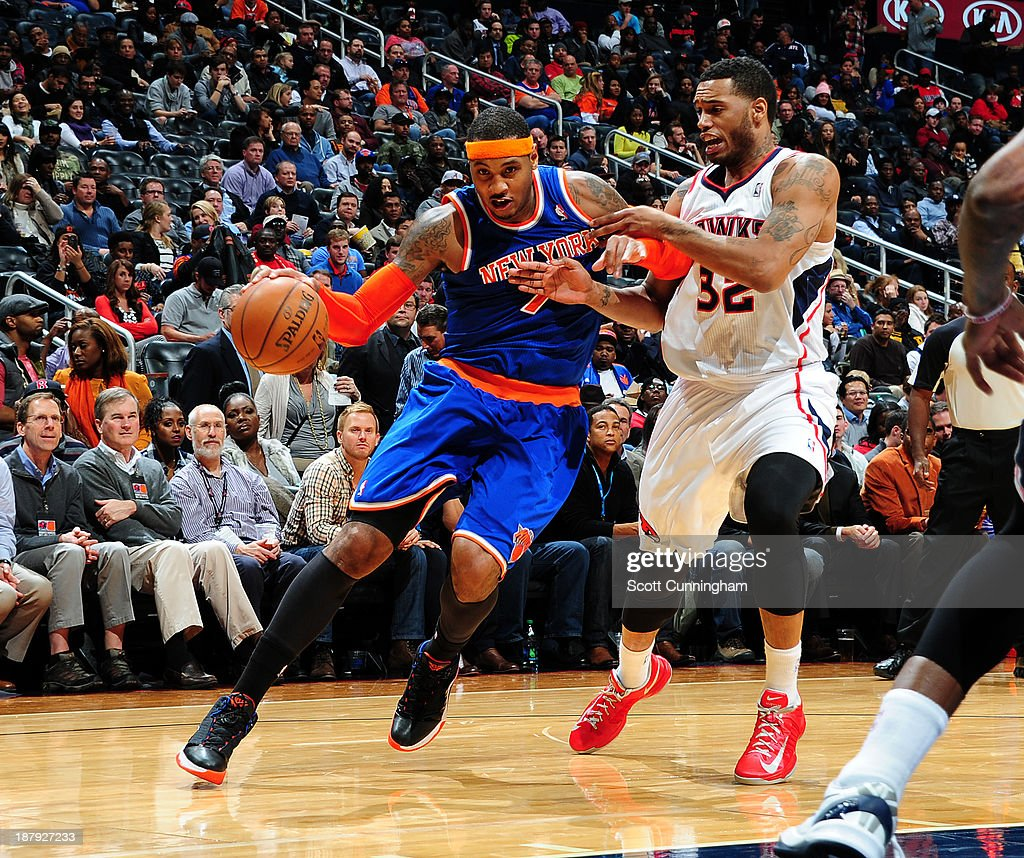 <a gi-track='captionPersonalityLinkClicked' href=/galleries/search?phrase=Carmelo+Anthony&family=editorial&specificpeople=201494 ng-click='$event.stopPropagation()'>Carmelo Anthony</a> #7 of the New York Knicks drives to the basket against the Atlanta Hawks on November 13, 2013 at Philips Arena in Atlanta, Georgia.